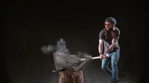 Man smashing cement block with hammer in slow motion, shot on Phantom Flex 4K at 1000 fps