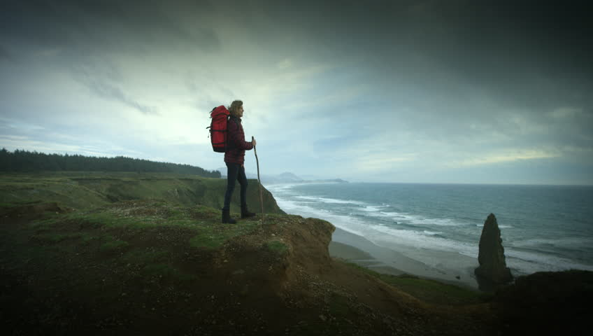 Woman hiking trail on cliffs on the Oregon Coast | Shutterstock HD Video #11303990