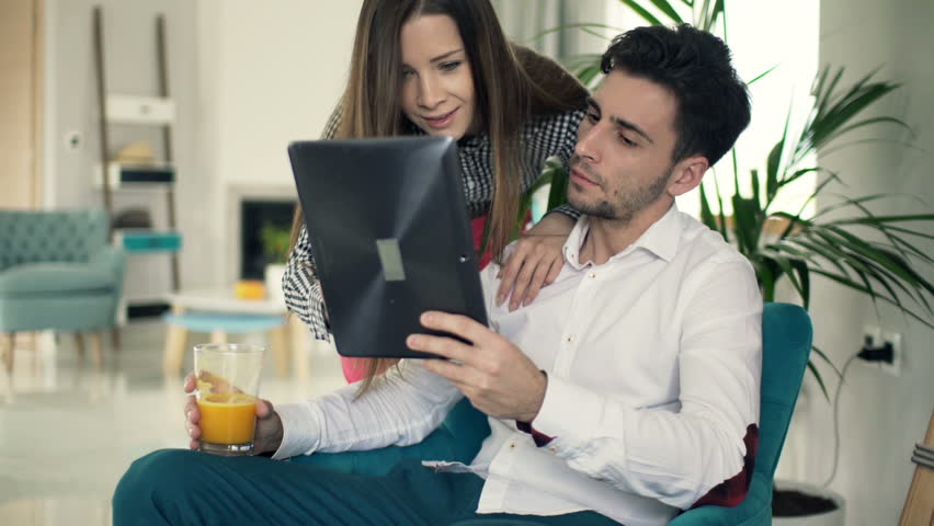 Young couple talking and using tablet computer at home  | Shutterstock HD Video #11305889