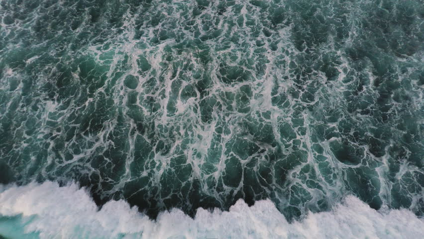 Aerial shot of waves in the tropical ocean