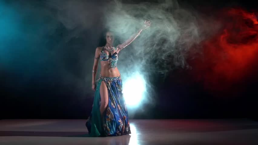 Talanted belly dance movements of young, great and attractive girl in exotic dress, starting, slow motion, in smoke, black background, blue, red, blue #11331950