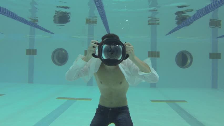 Slow Motion Professional Man Swimmer Inside Swimming Pool