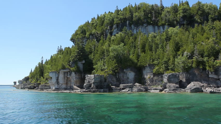 Passing the cliffs and trees of Flowerpot Island in Tobermory, Ontario, Canada.