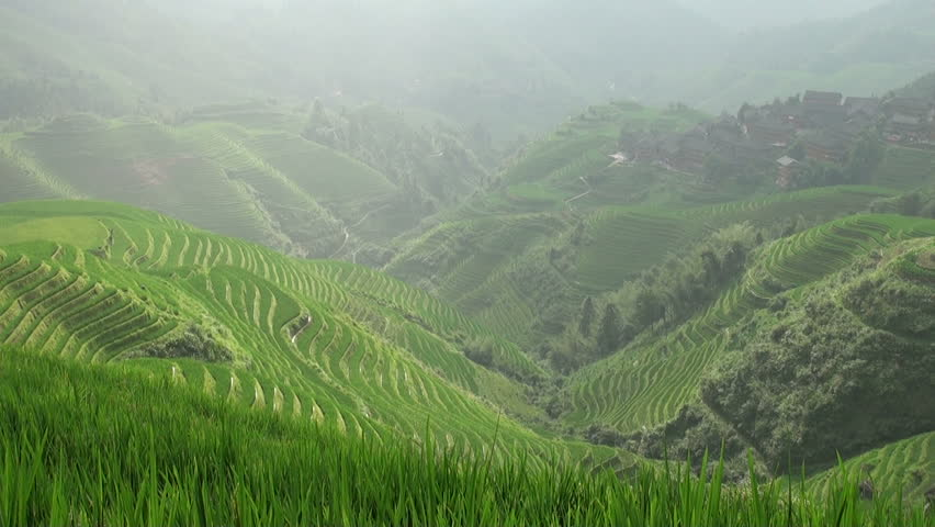 Time lapse of village and rice terraces in Guangxi province.