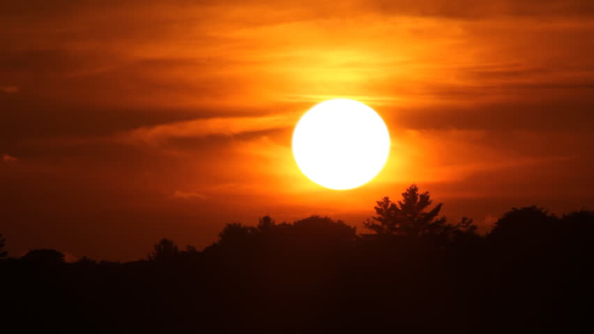 Fast and firey orange summer sunset. Time lapse. Sun sets behind tree. Muskoka, Ontario, Canada.   | Shutterstock HD Video #11390720