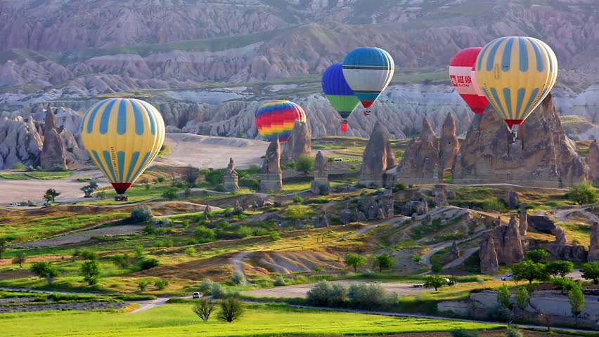 TURKEY, GOREME - MAY 19, 2015 - Multi-colored balloons fly over rocks.The greatest tourist attraction of Cappadocia , the flight with the balloon
