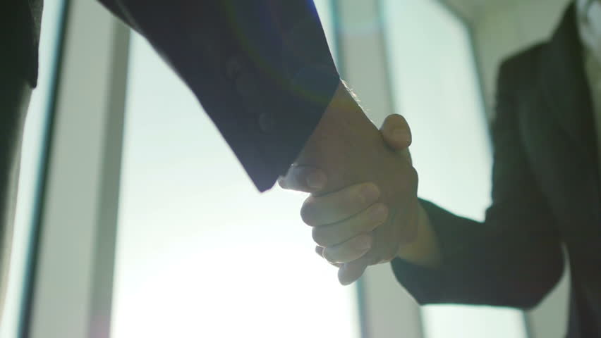 Two business partner shake hands when meeting. In slow motion | Shutterstock Video #11397464
