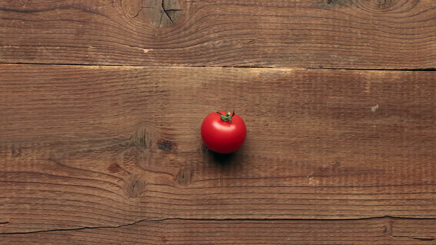 Rapid changing of different vegetables on wooden background - stop motion animation