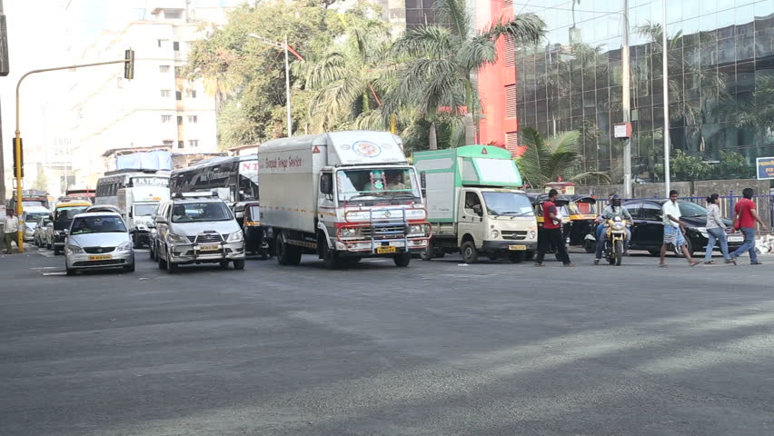 mumbai india 16 january 2015 vehicles and people passing down the street in - Yellow Restaurant 2015