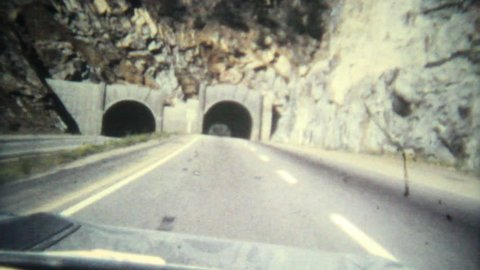 vintage driving through tunnel on interstate system 8mm transfer 1080p