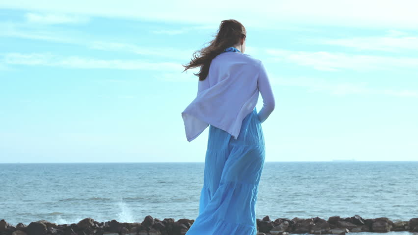 Image result for woman by the sea
