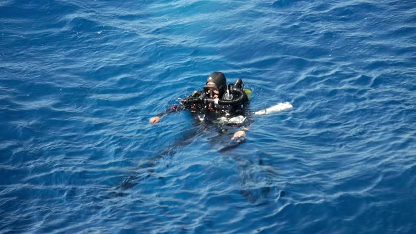 CYPRUS - 2.08.2015: a scuba diver team dive to zenobia wreck - HD