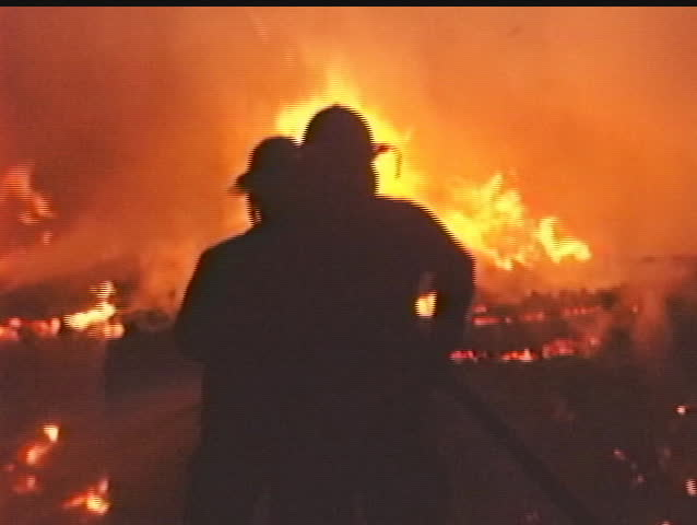 Firefighters Silhouetted by fire