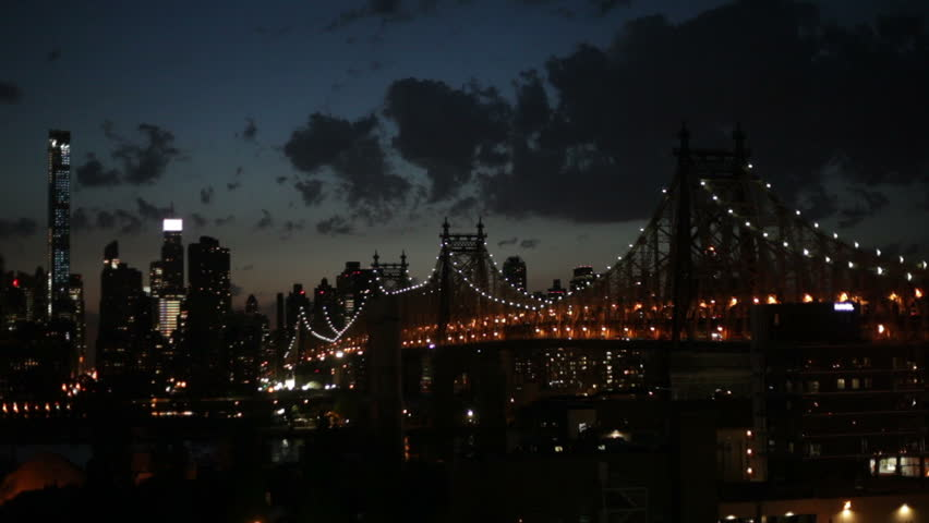 Night scene of Manhattan and traffic at the Ed Koch Queensboro Bridge a cantilever bridge over the East River in New York City, USA.