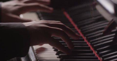 Piano music pianist hands playing. Musical instrument grand piano details 4K