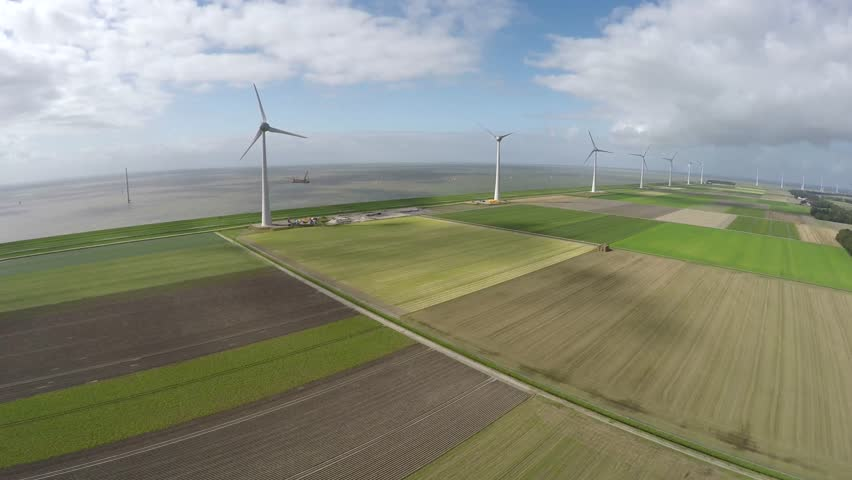 Aerial of wind turbine wind park view from above bird eye helicopter view green engineering near sea providing wind energy green energy renewable energy showing mast and blades aerofoil-powered 4k