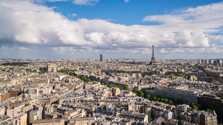 City, Arc de Triomphe and the Eiffel Tower, viewed over rooftops, CIRCA 2015- Paris, France - timelapse
