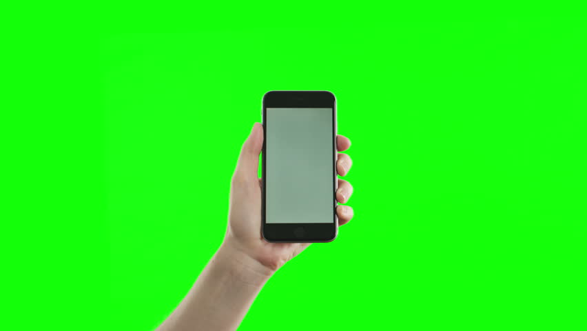 Female hand holding the newest smartphone on green screen. The last phone model.  You can track it easily putting the trackers on the screen corners.