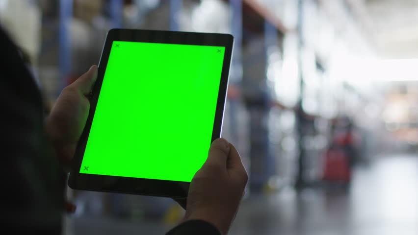 Holding Tablet PC with Green Screen in Logistic Warehouse. Mock-up. Shot on RED Cinema Camera in 4K (UHD). | Shutterstock HD Video #11615240