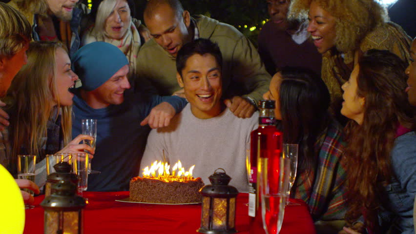 Happy Group Of Friends At Outdoor Birthday Party Man Blows Out Candles On His Cake Shot RED Epic