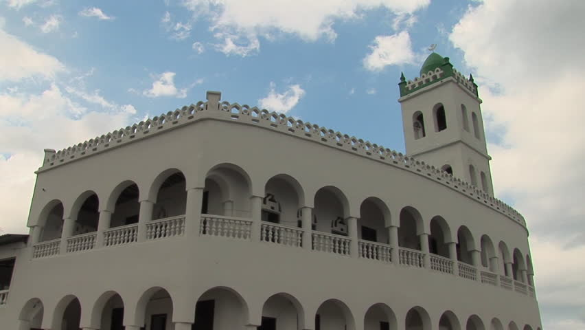 White mosque in Moroni, Grande Comore in the Comoros against a bright blue sky with white clouds