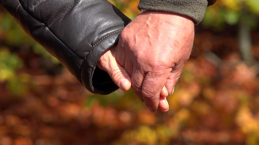 Autumn Holding Hands