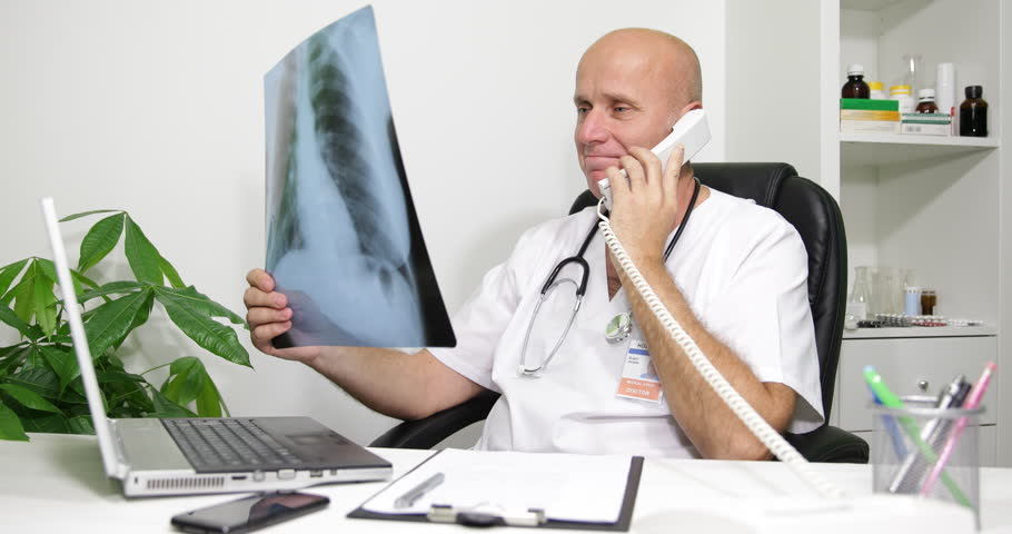 Examination Room Doctor Talking Phone X Ray Examination Positive News Patient US ( Ultra High Definition, UltraHD, Ultra HD, UHD, 4K, 2160P, 4096x2160 ) | Shutterstock HD Video #11634170