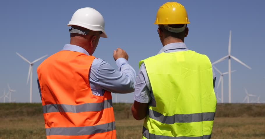 Two Engineers Cooperation Wind Turbines Mills Farm Men Collaboration People Talk ( Ultra High Definition, UltraHD, Ultra HD, UHD, 4K, 2160P, 4096x2160 )