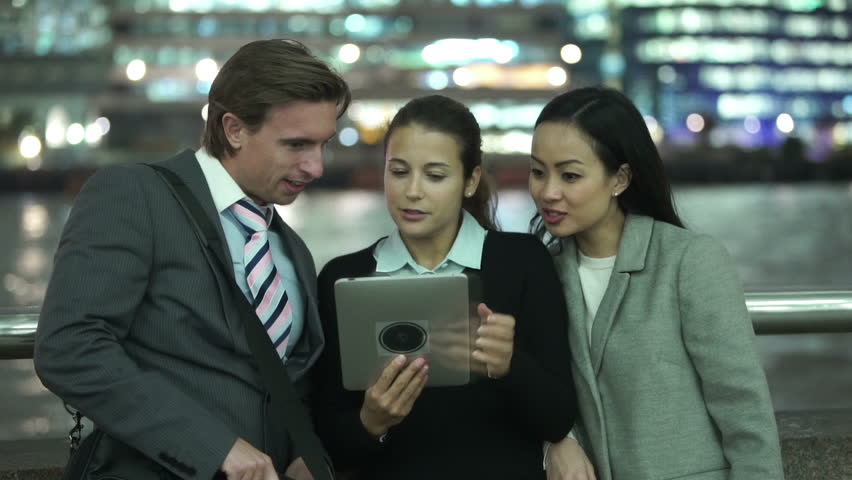 Portrait of attractive young professional group using computer tablet in the city at night. Shot on RED Epic | Shutterstock HD Video #11635460
