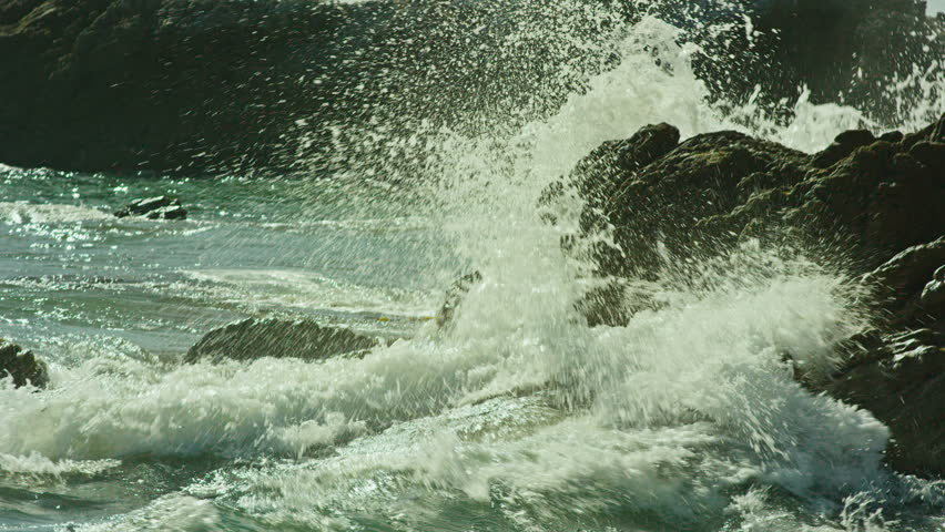 4k Ocean Waves Breaking On The Rocks. Wave crushing coast. Sea waves crash against the rock.  Slow motion. Shot on RED EPIC Cinema Camera.