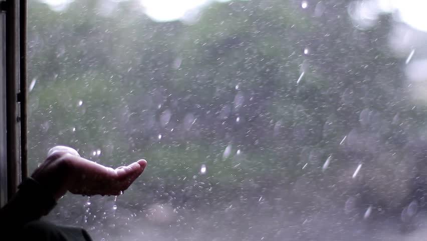 Window of the train. Heavy rain through the window of the train. Man rejoices of the rain. | Shutterstock HD Video #11647274