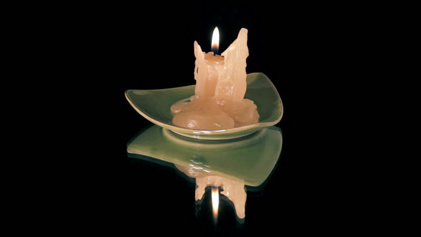 Candle on completely black reflective surface   Shutterstock HD Video #1165990