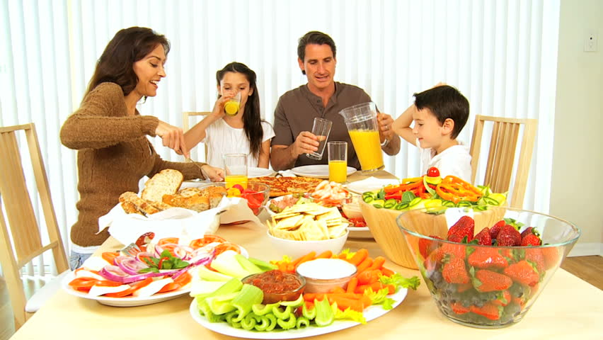 Healthy young family sharing a nutritious meal together