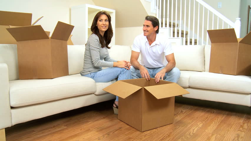 Children bringing in more boxes to be unpacked after house move | Shutterstock HD Video #1166830