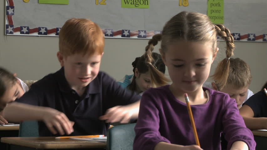 Boy pulling a girls pig tail in class | Shutterstock HD Video #11677799