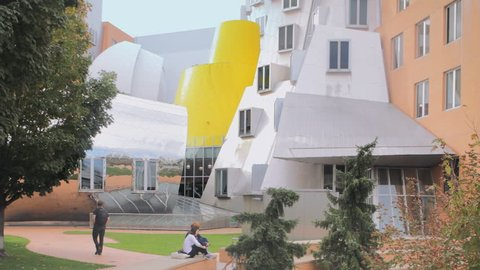 CAMBRIDGE, MA- SEPT 16, 2015:  Students walk through MIT Massachusetts Institute of Technology college campus on September 16, 2015. Modern architecture by Pritzker Prize-winning architect Frank Gehry