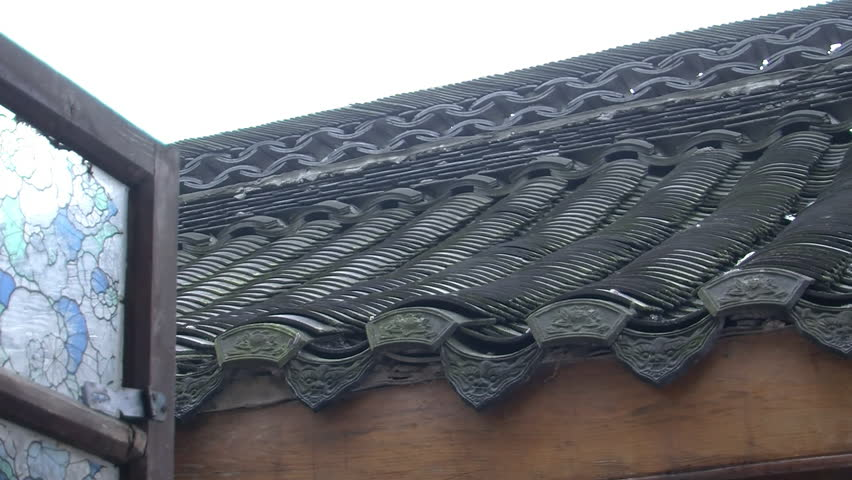 Great Chengdu, China   July 2010: Close Up Of An Ornate Chinese Roof With Slate Roof  Tiles And A Stained Glass Window. Chengdu, China.