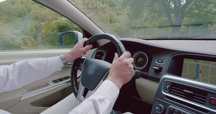 Shot of middle aged male driver's hands holding a steering wheel during the drive | Shutterstock HD Video #11786300