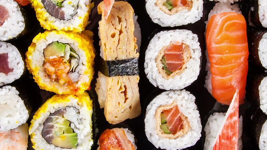 Slide motion of sushi food served on black stone