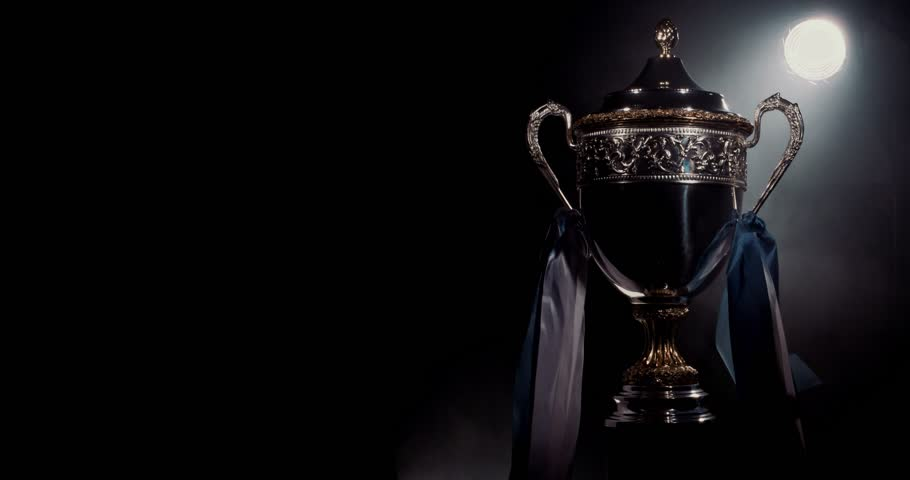 champion silver trophy on black stock footage video