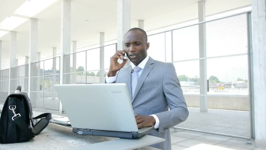 Businessman working with laptop computer outside the office