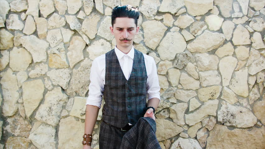 A young man with a mustache, wears a jacket | Shutterstock HD Video #11893190