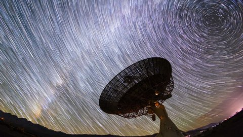Night Sky Star Trails Timelapse Over Giant Satellite Receiver Dish
