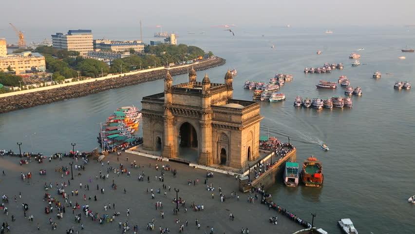 India - March 2015: Mumbai Gateway India Maharashtra Asia monument sunset vessel building sea city people palace harbour travel
