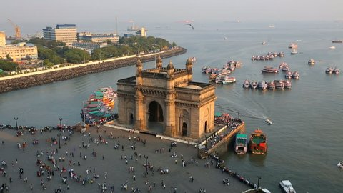 India - March 2015: Mumbai Gateway India Maharashtra Asia monument sunset vessel building sea city people palace harbour travel