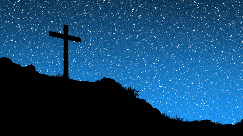 The heavens spinning behind a silhouette of jesus cross on stars behind cross hd stock video clip voltagebd Gallery