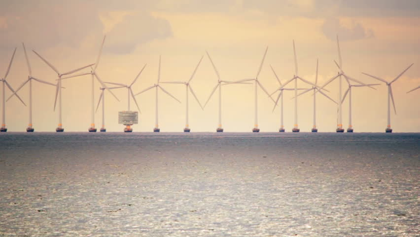 Green energy electricity ocean windfarm sunset Malmo Sweden Copenhagen Denmark