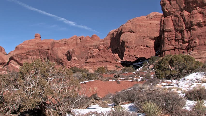 Video pan left of Arches National park in southern Utah near Moab. Double Arch and desert valley.    Shutterstock HD Video #119950