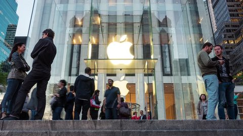 NEW YORK - MAY 14, 2015: Apple store entrance on 5th Avenue in Manhattan. As of 2014, Apple employs 72,800 permanent full-time employees, maintains 437 retail stores in fifteen countries. Time lapse.