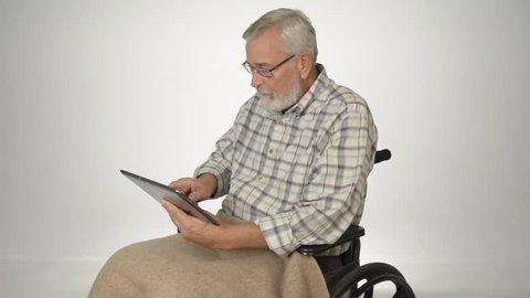 Senior man looking at porn on a tablet